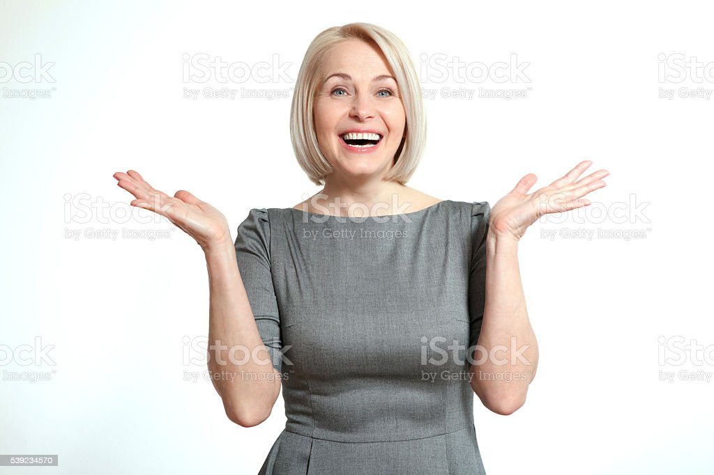 Friendly smiling middle-aged business woman isolated on white background. royalty-free stock photo