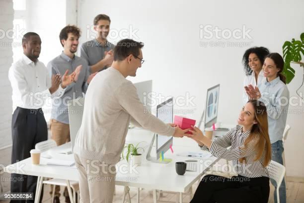 Friendly team congratulating female colleague with birthday gift and picture id953656284?b=1&k=6&m=953656284&s=612x612&h=ciqoxa ijqw5gpgosxsnvbwlktfad hbbw4eg952fxq=
