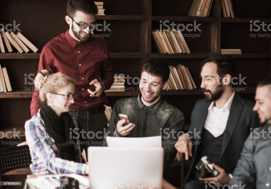 friendly team of copywriters in the workplace in modern office stock photo