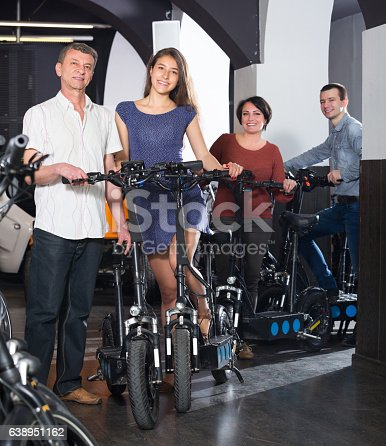 istock Friendly two couples hiring bicycles 638951162