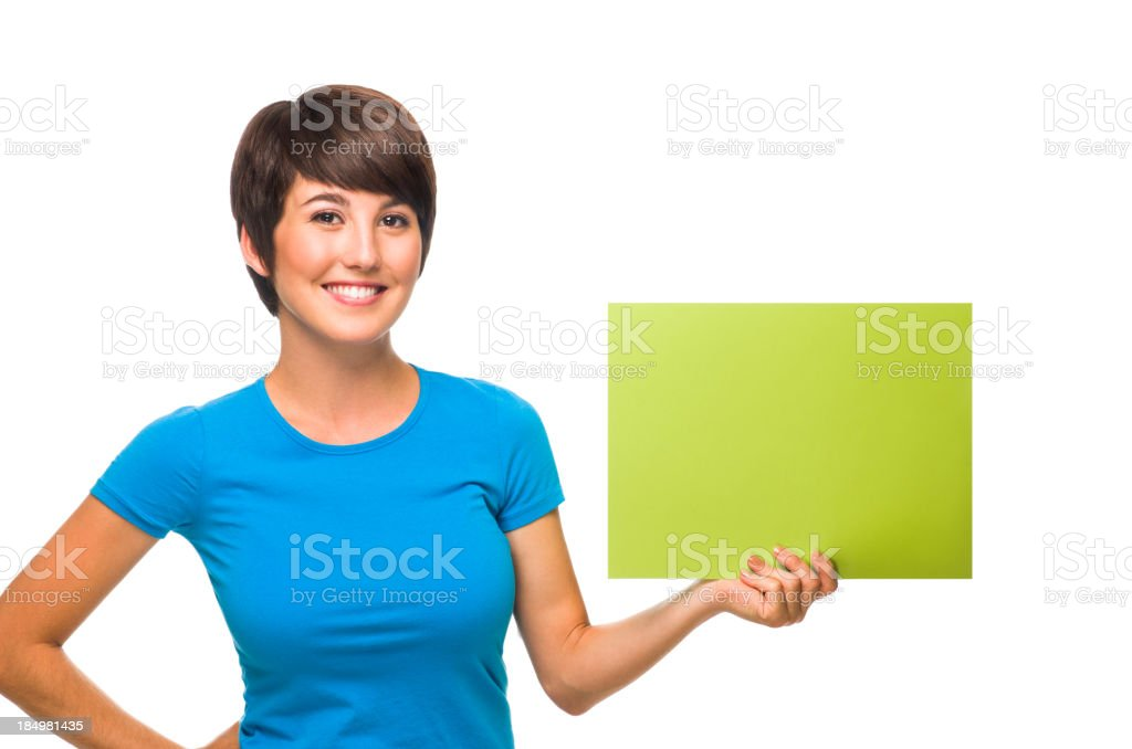 Friendly woman holding a small blank sign royalty-free stock photo