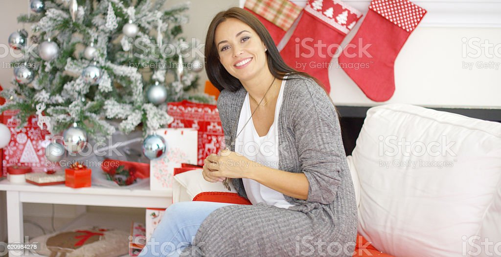 Friendly young woman relaxing at home  Christmas foto royalty-free