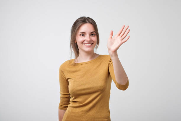 Person Waving Hello Stock Photos, Pictures & Royalty-Free ...