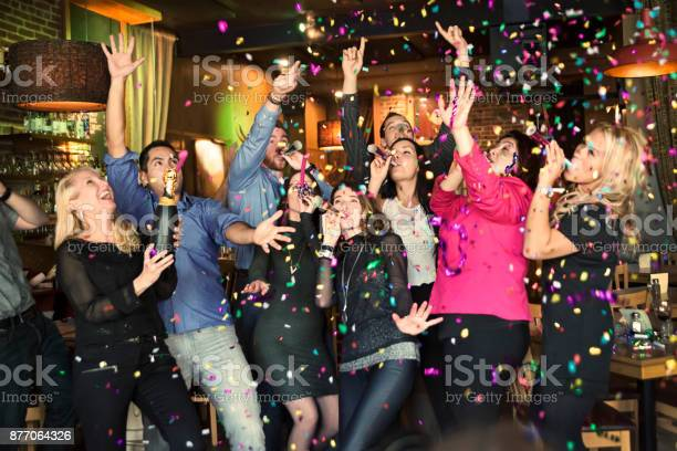 Friends and coworkers celebrating with confettis in a bar picture id877064326?b=1&k=6&m=877064326&s=612x612&h=pc  vl1ph8v2wa2yzlmnzrl icwuoh0uwqikqtxez y=