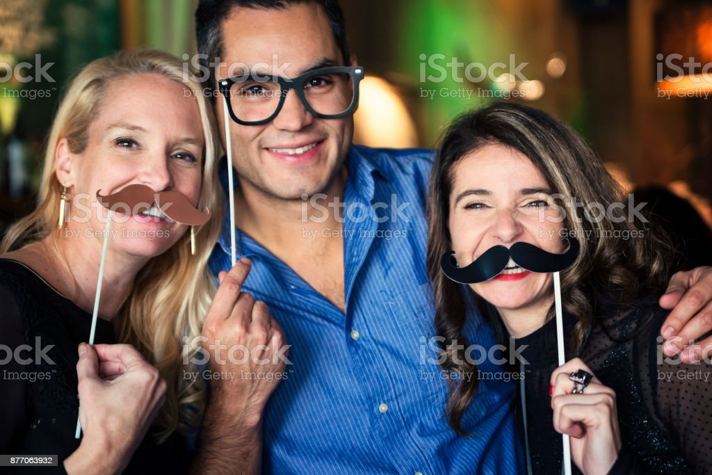 Friends and coworkers photo booth at a party in a bar. stock photo