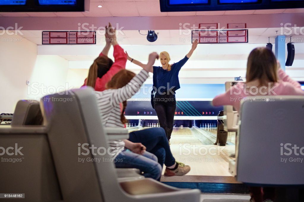 Friends and family play Bowling stock photo
