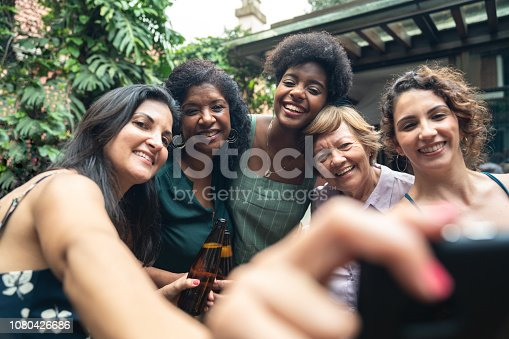 istock Friends and Family Taking a Selfie at Barbecue Party 1080426686