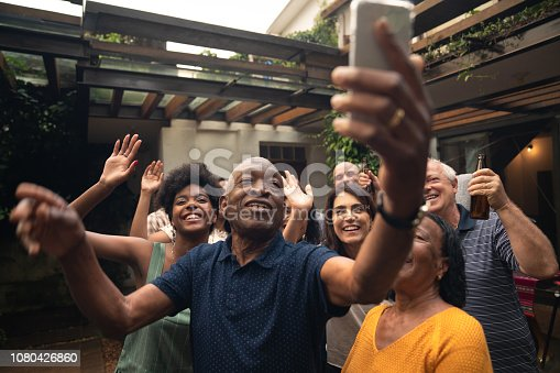 istock Friends and Family Taking a Selfie at Barbecue Party 1080426860