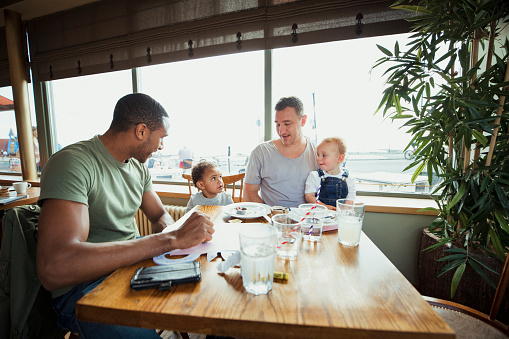 Friends And Sons Having Lunch Stock Photo - Download Image Now