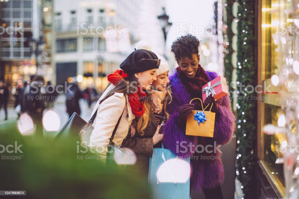 Friends are buying Christmas presents stock photo