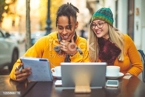 684006316istockphoto Friends are having fun in the city - autumn mood 1055866776