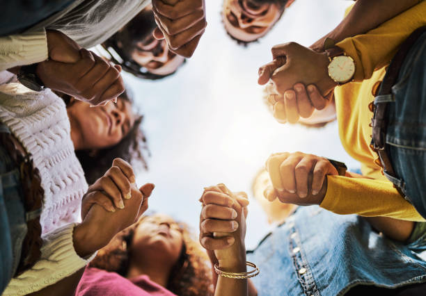 Friends are there when you need them most Cropped shot of a group of friends holding hands religion stock pictures, royalty-free photos & images