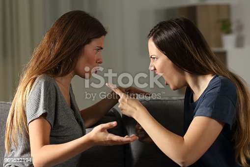 istock Friends arguing and shouting at home 969532194