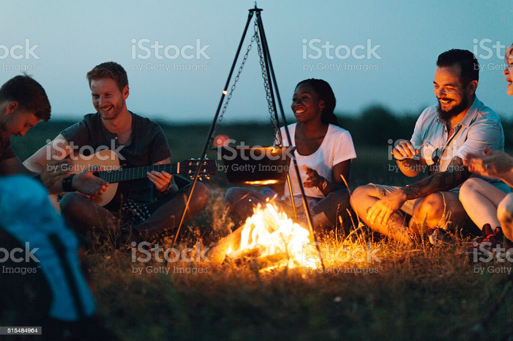 Friends around the campfire stock photo