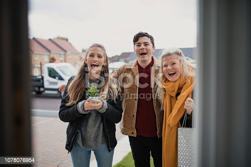 istock Friends Arriving for Social Gathering 1078076954