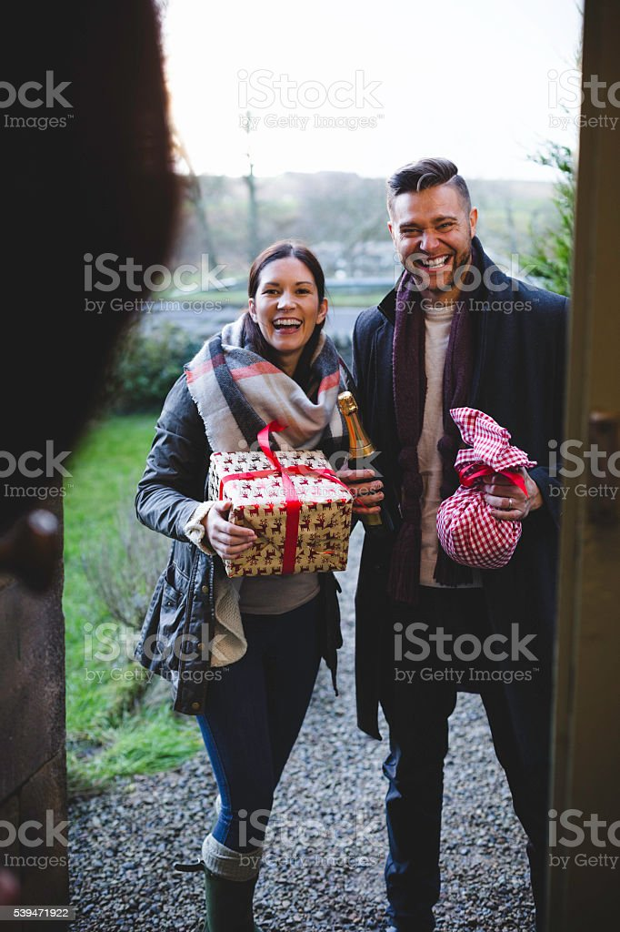 Friends Arriving with a Gifts stock photo