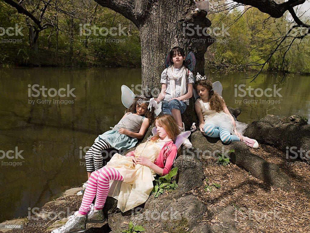 Friends asleep by a tree 免版稅 stock photo