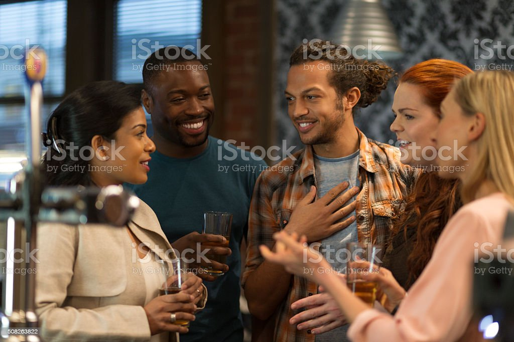 Friends at a bar stock photo