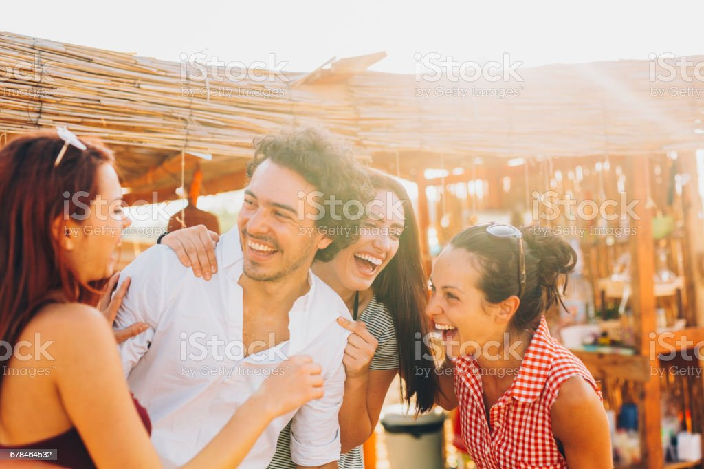 Friends at a beach camp royalty-free stock photo