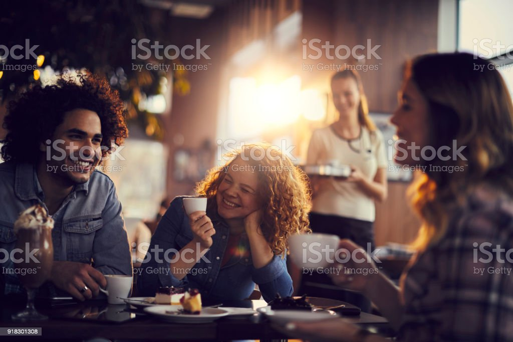 Friends at a cafe stock photo