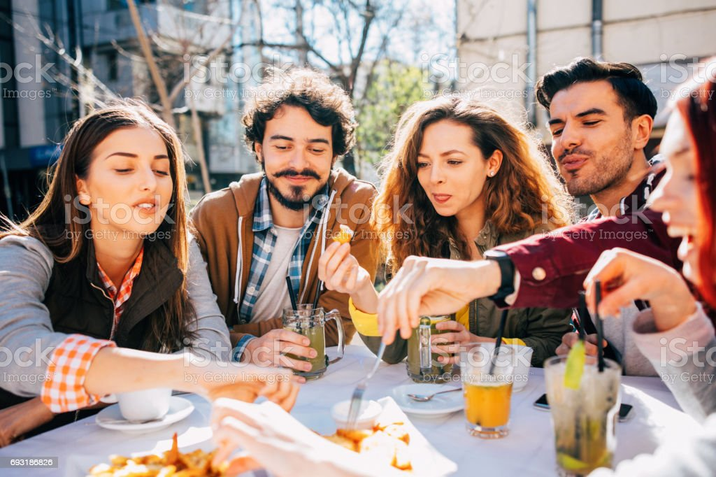 Friends at a restaurant stock photo