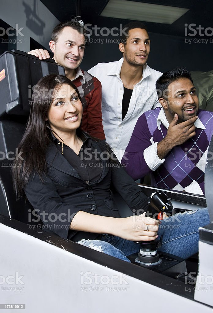 Friends at an arcade stock photo