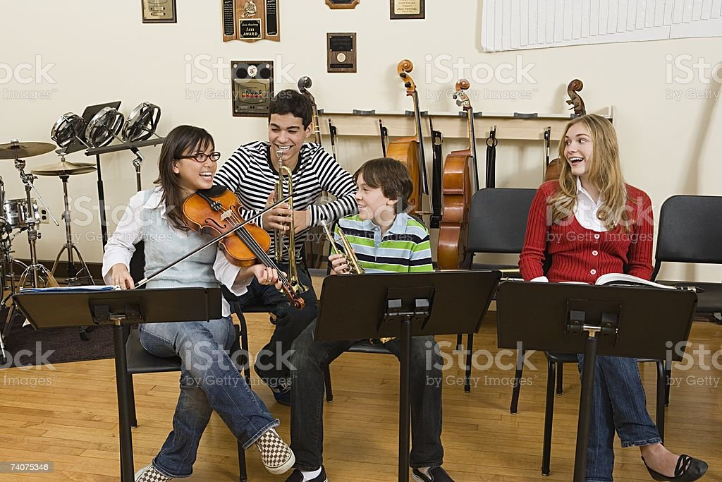 Friends at band practice stock photo