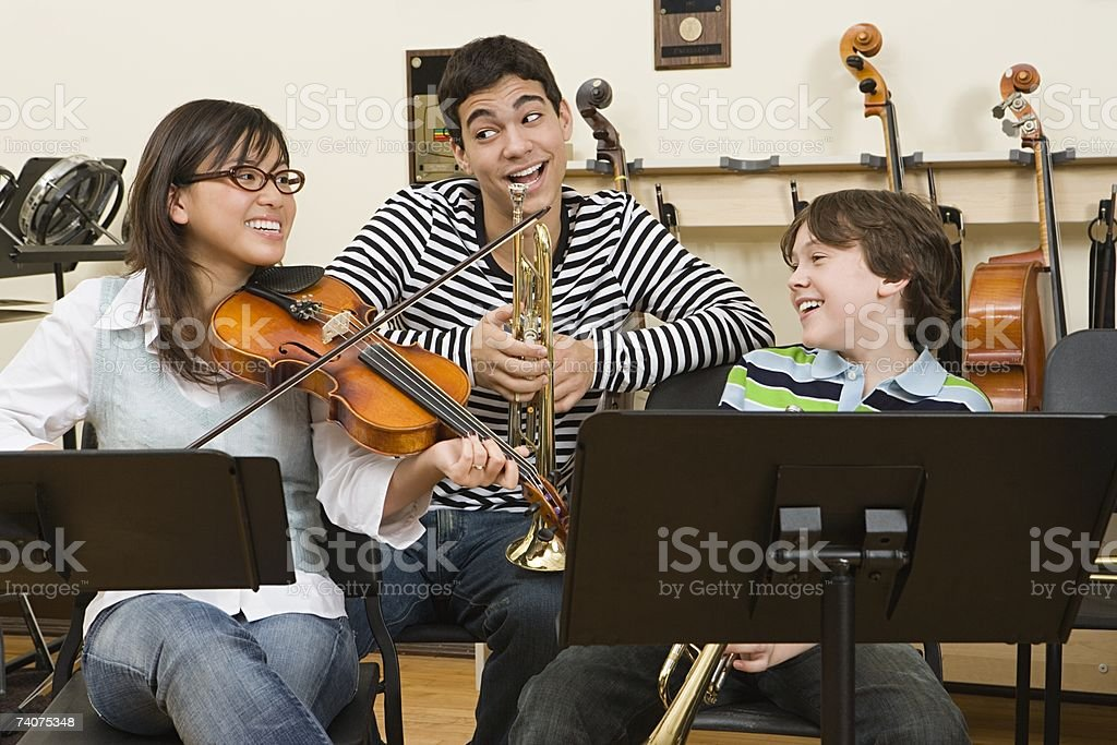 Friends at band practice royalty-free stock photo