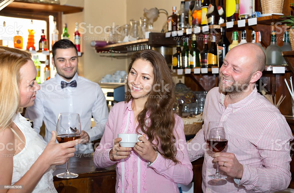 Friends at bar with barman stock photo