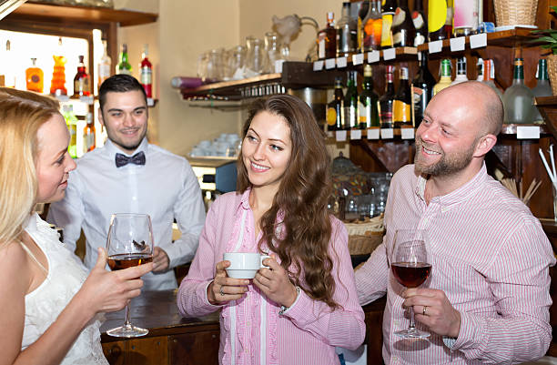 friends at bar with barman - young singles stock photos and pictures