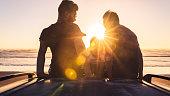 Enjoying sunset at Muriwai Beach, Auckland, New Zealand.