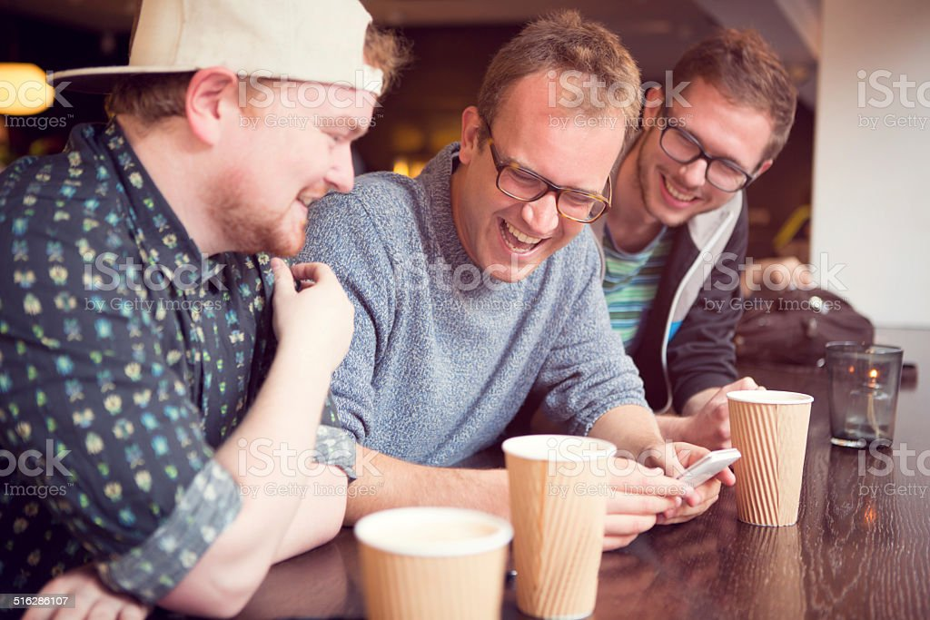 Friends at cafe. stock photo
