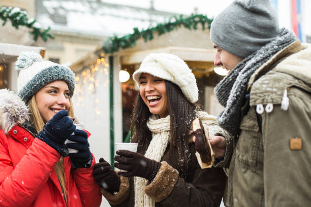 friends at christmas market at daytime - hot chocolate stock photos and pictures