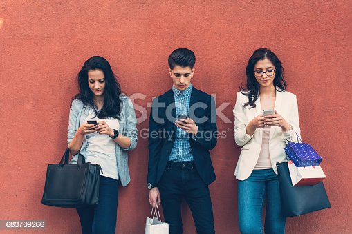 istock Friends at colorful wall texting 683709266