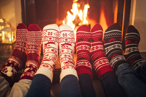 friends at cozy winter vacation. - fireplace stockfoto's en -beelden