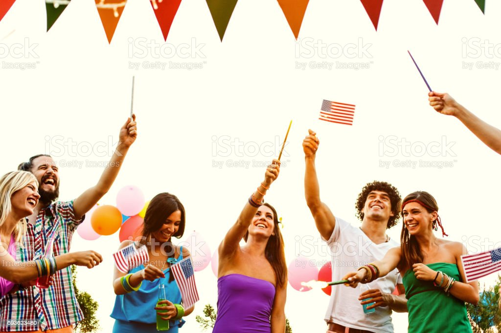 Friends at Independence day party. stock photo