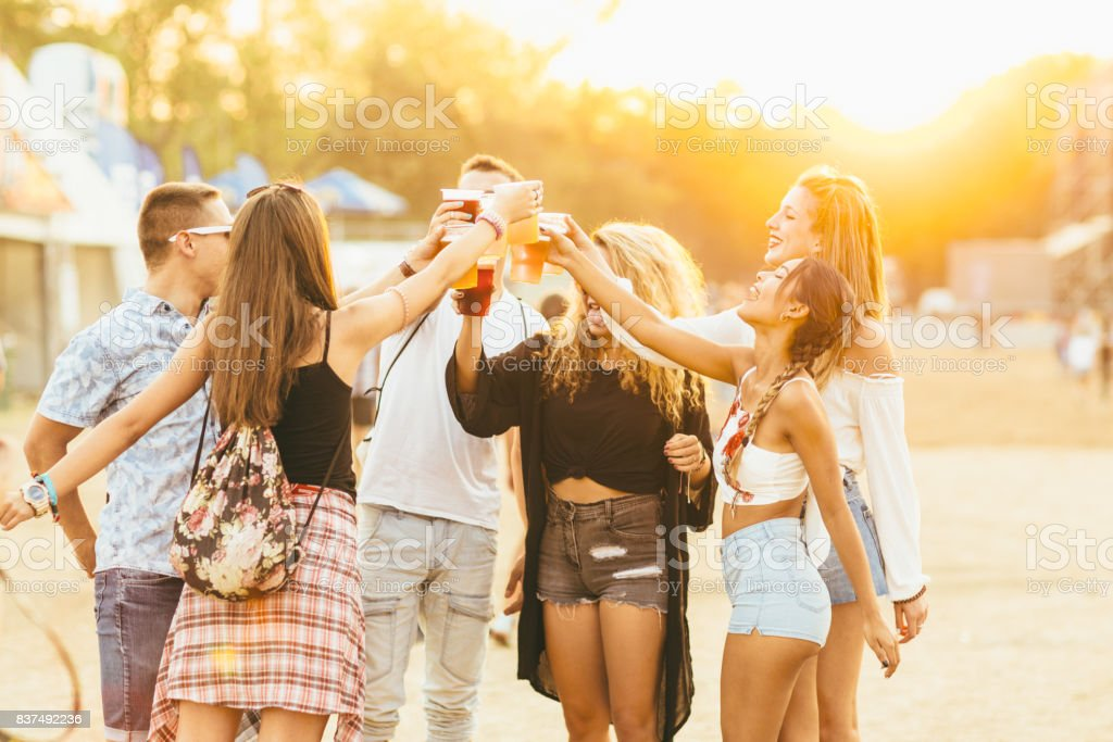 Friends at music festival stock photo