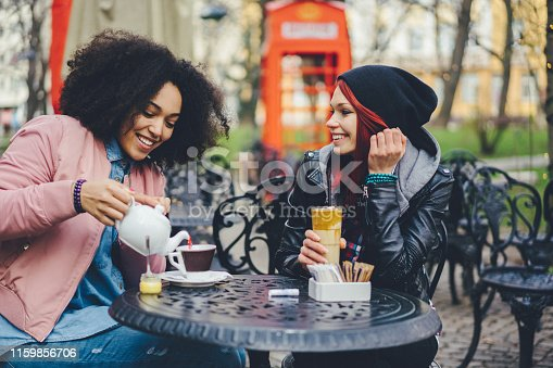 Two friends drinking tea and talking