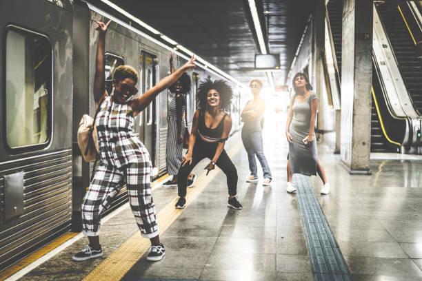 Friends at subway station stock photo