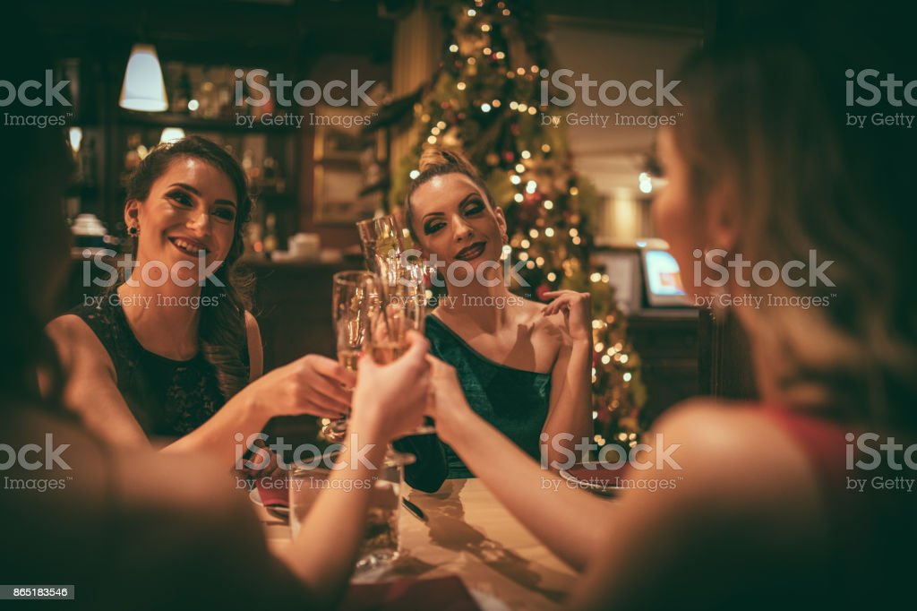 Friends at the dinner party stock photo