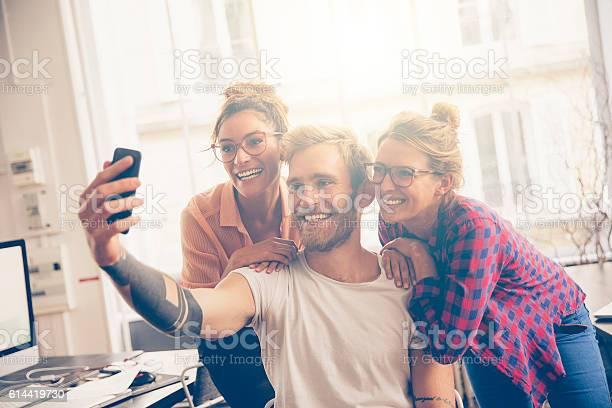 Friends at work taking self portrait with camera phone picture id614419730?b=1&k=6&m=614419730&s=612x612&h=szc uft dg0 gptq5vbltc2iz3h4qeheh7x1intyl74=