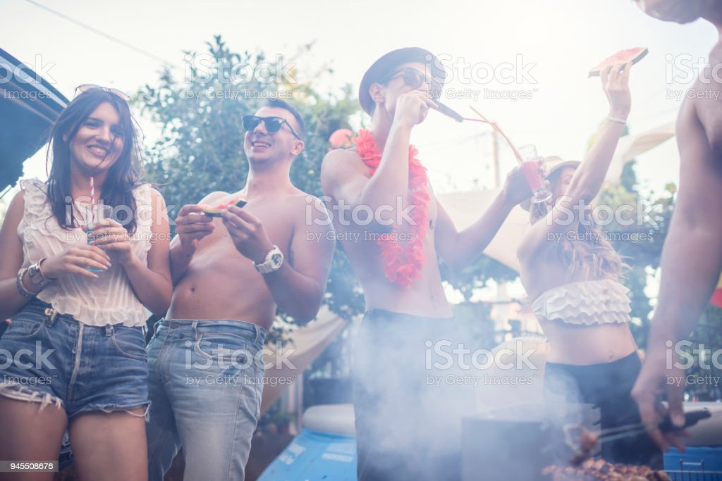 Group of friends have a party time by the poolGroup of friends have a...