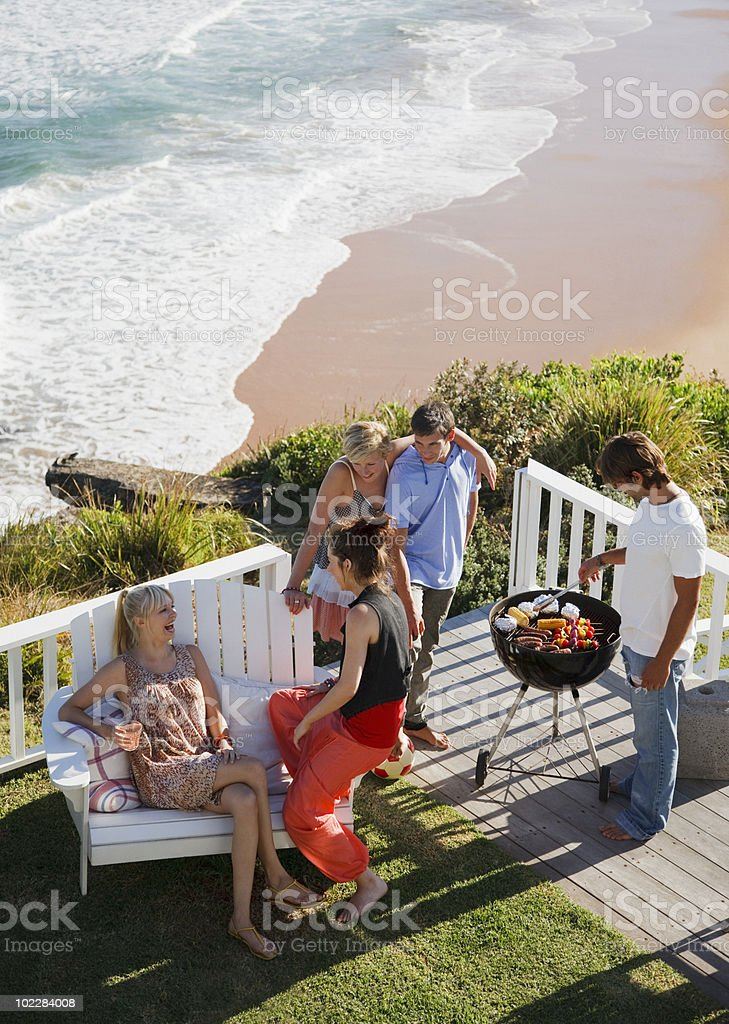 Friends barbecuing stock photo