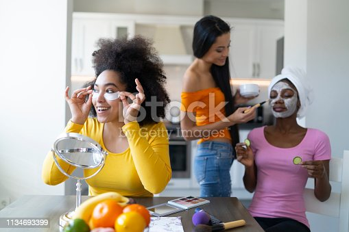 Friends having fun and doing beauty treatment