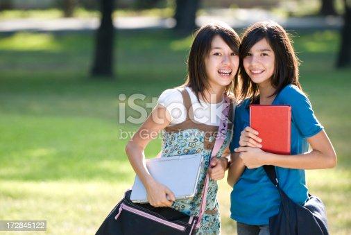 1127798356 istock photo Friends between clases 172845122