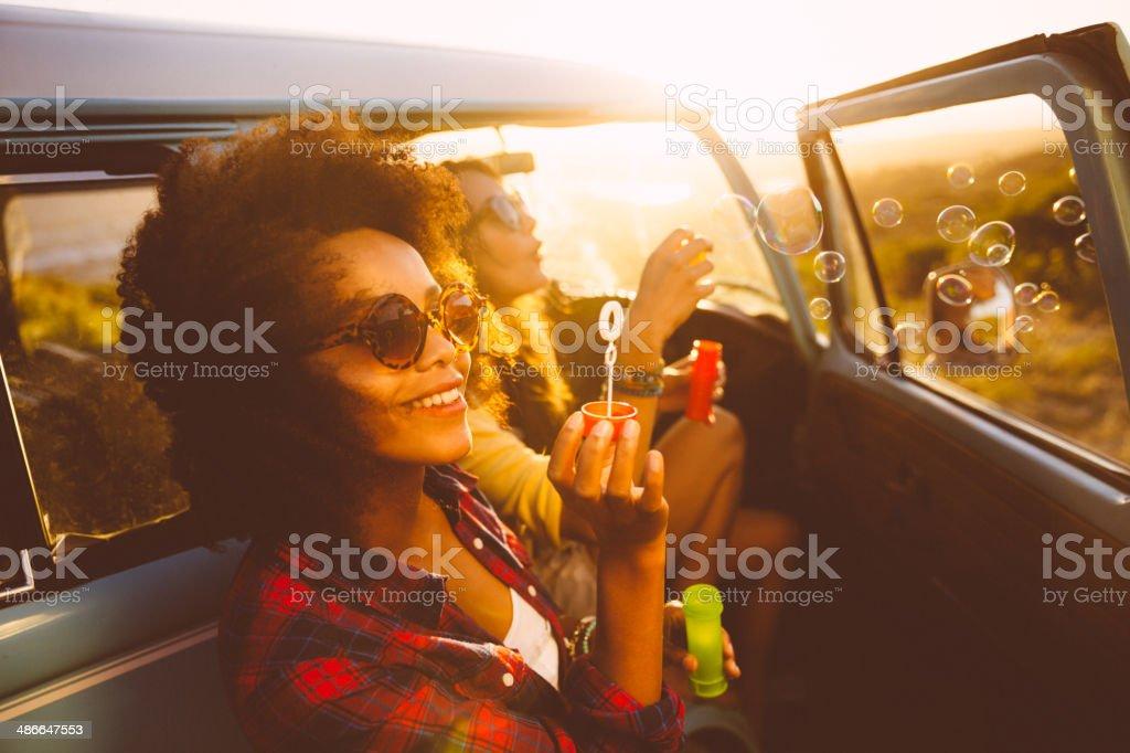 Friends blowing bubbles on roadtrip
