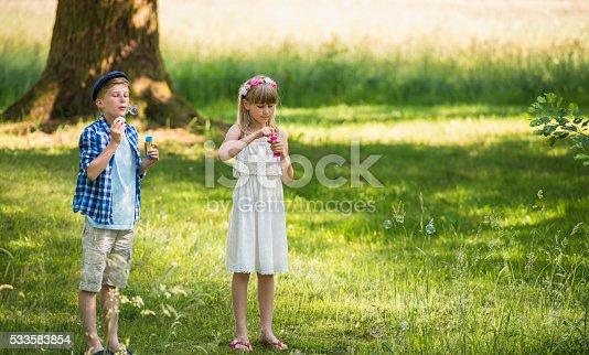 istock Friends Blowing Bubbles 533583854