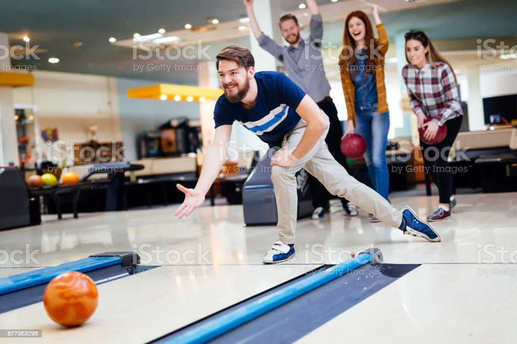 Friends bowling at club stock photo
