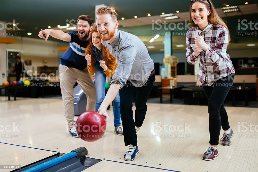 Friends bowling stock photo