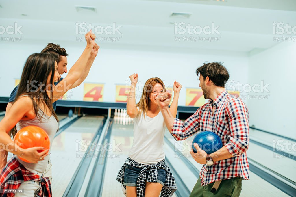 Friends Bowling Together. stock photo